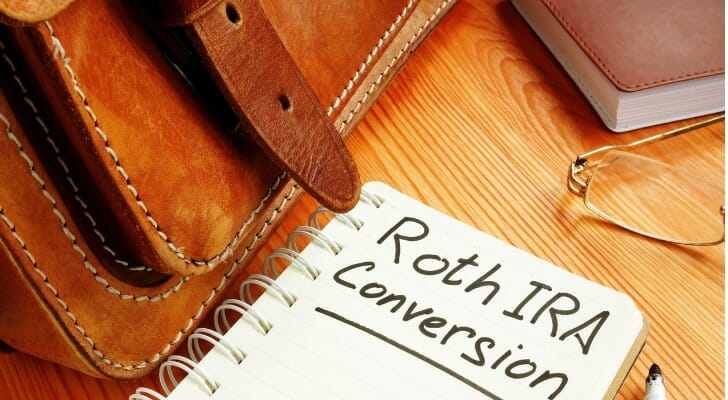 "Notebook with ""Roth IRA Conversion"" written on one of the pages"