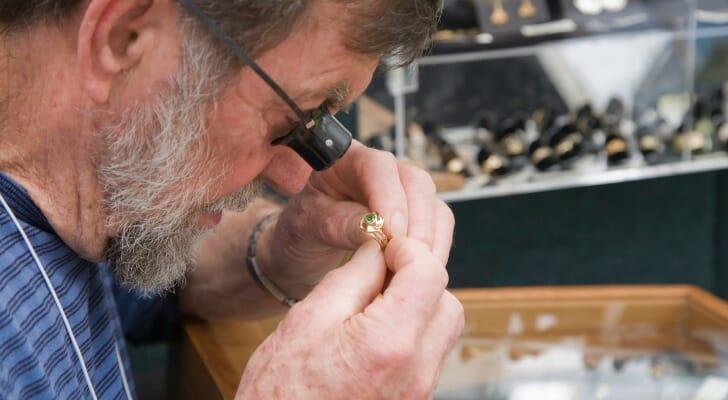 Jeweler appraising engagement ring
