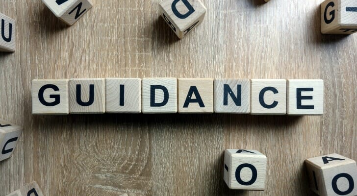 "Letter blocks arranged to spell the word ""guidance"""