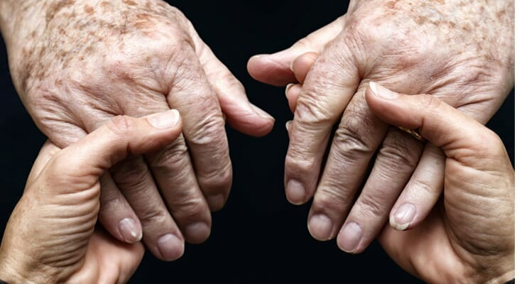A pair of hands seen holding another pair of hands