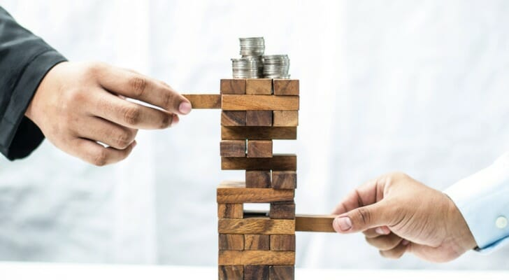 Stack of wooden blocks with coins on top