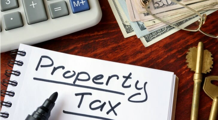 """PROPERTY TAX"" written on a piece of paper"