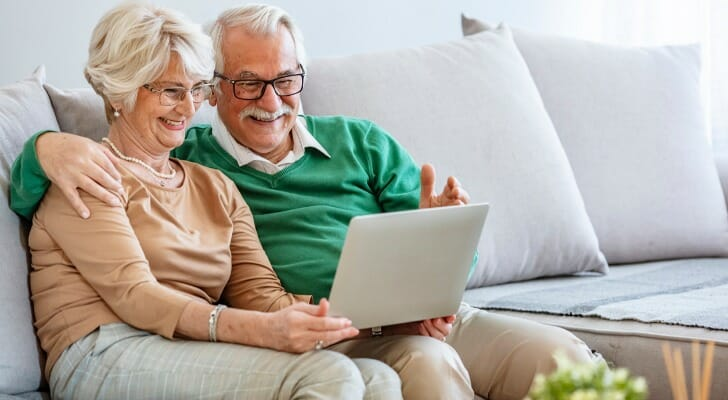 Happy elderly couple planning for their retirement