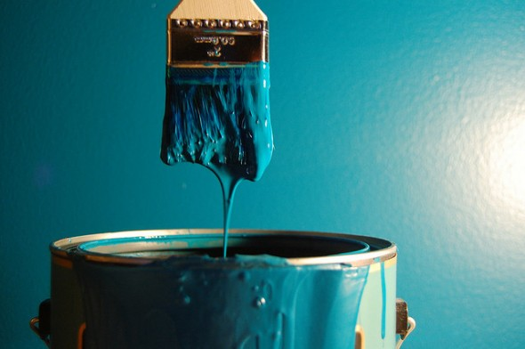 Paintbrush dipping in paint can - 5 Cheap and Easy Ways to Boost Your Home's Value