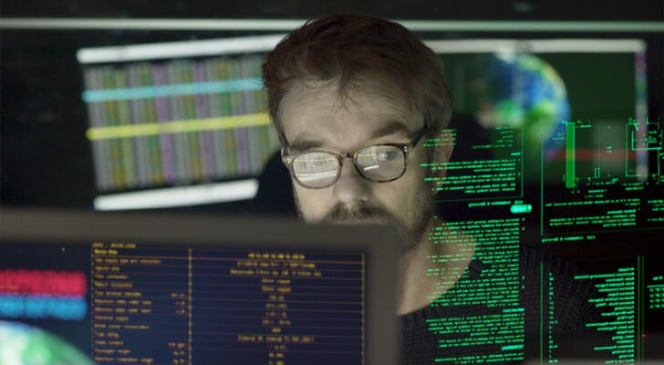 An investor sitting in front of his screens