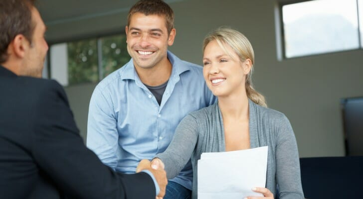 A happy couple working with their financial advisor
