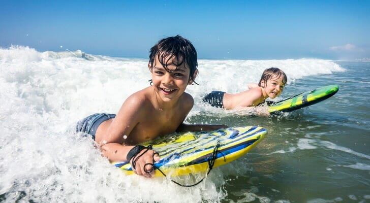 Two boys surfing off the coast of North Carolina