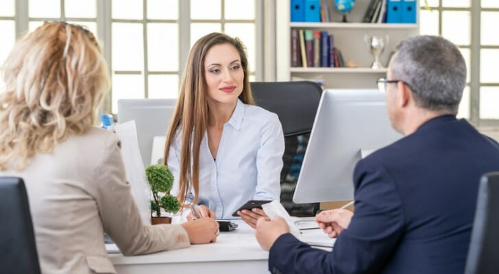 A couple discusses estate planning with their financial advisor
