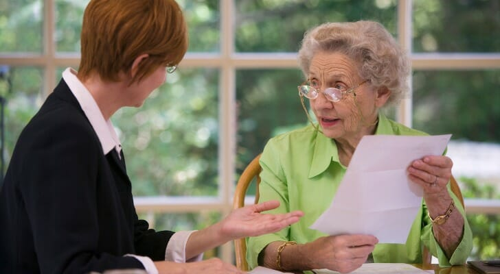 Elderly woman discusses her will with an attorney