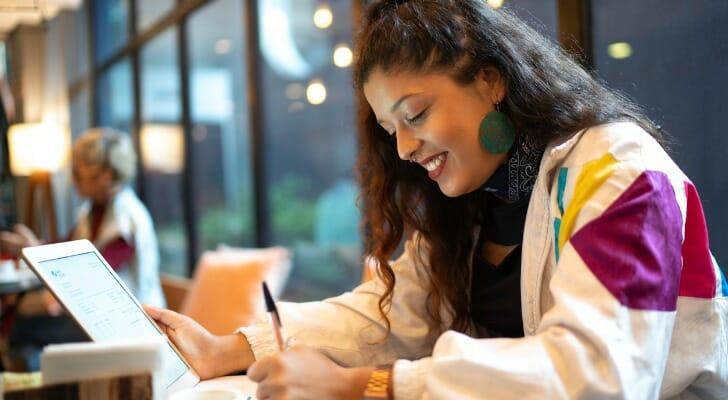 Woman analyzes an income statement