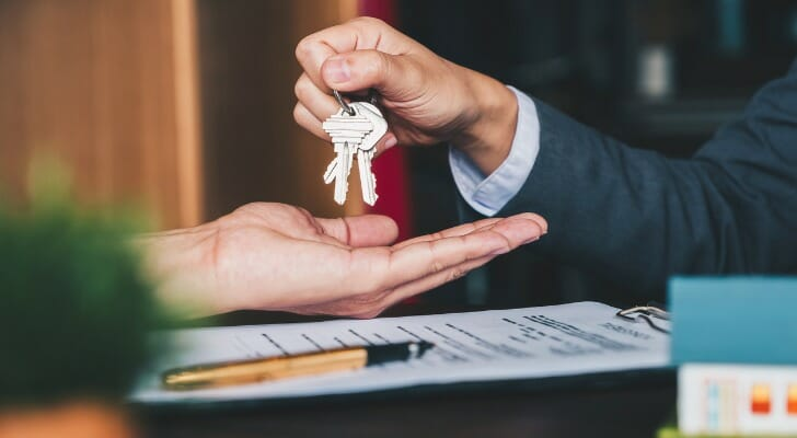 Business owner gives keys to his business to the buyer