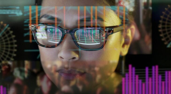 Woman in front of a see-through data screen