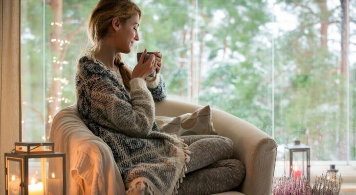 A Finnish woman enjoying hot tea during winter
