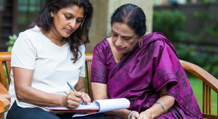 An Indian woman working on her living will with a lawyer