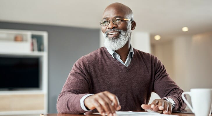 Older man checking his investments