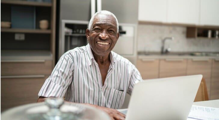 A retired man checks his investments