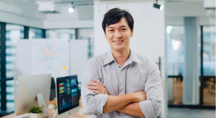 Young Asian male investor