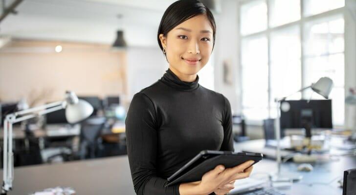 Asian woman checks her portfolio