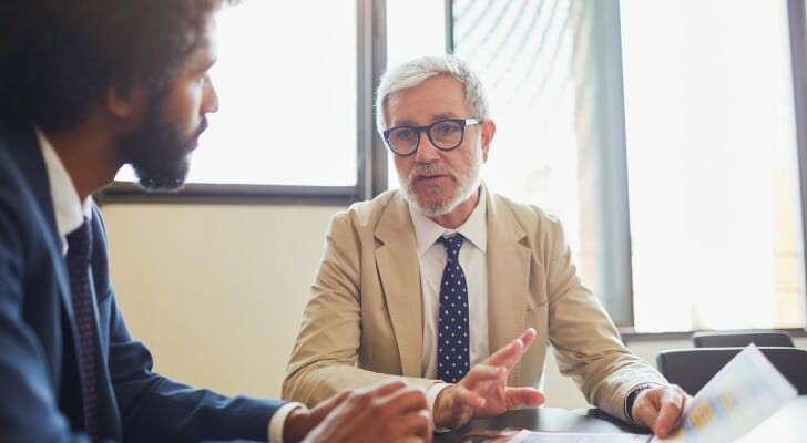 An investor talks with his financial advisor