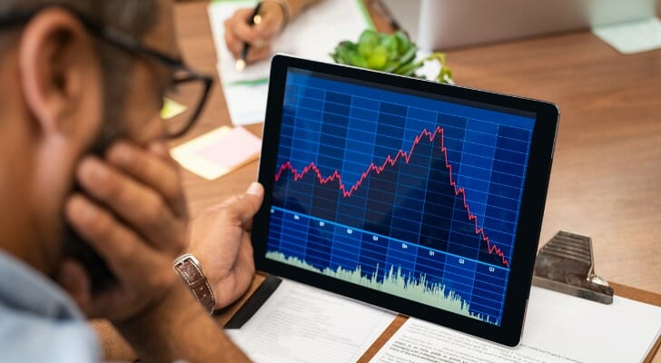 Investor looks at a digital stock price chart