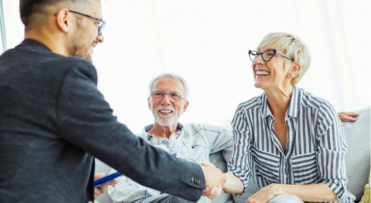 Senior couple talks with a financial advisor