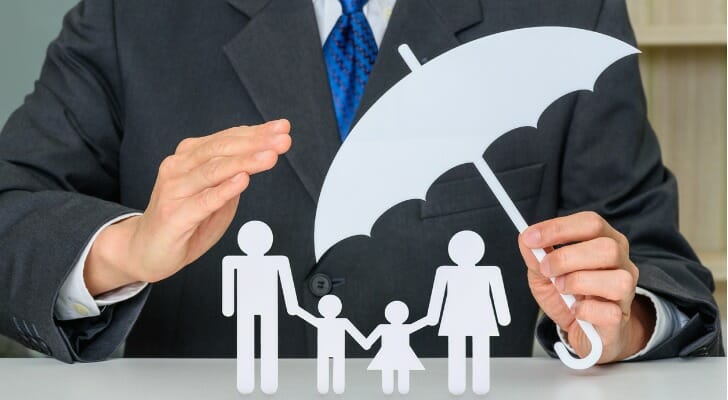 Businessman protecting family
