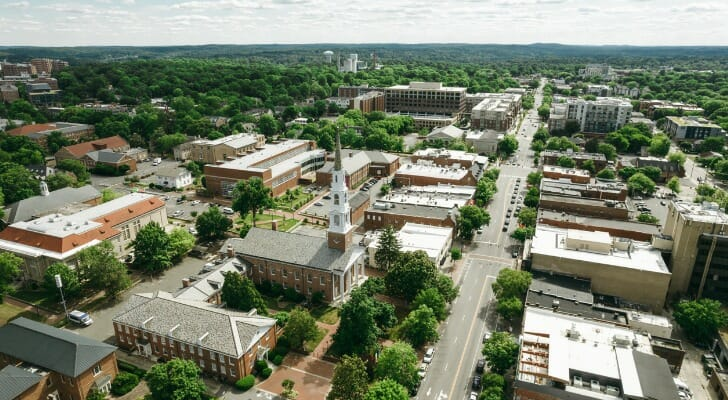Image shows an aerial view of Chapel Hill, North Carolina. SmartAsset analyzed data from various sources to identify and rank the most livable college towns in the U.S.