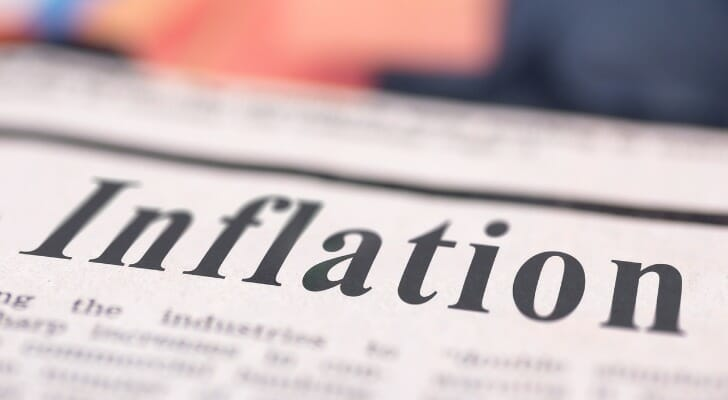 Image shows a newspaper front page with the headline 'Inflation.