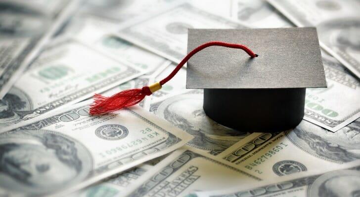 College graduation cap on cash
