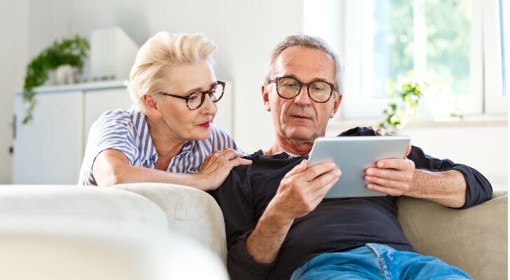 A couple looks over their retirement savings. A recent survey found that Americans believe they need $1.9 million saved by retirement.
