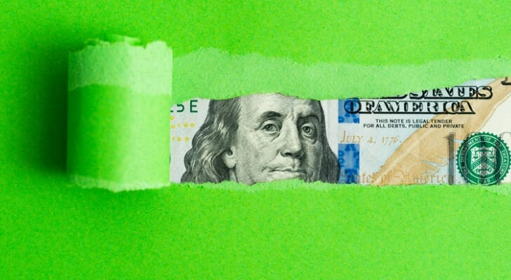 Currency behind green paper
