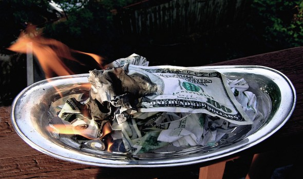 burning money 6 Insurance Policies Youre Wasting Money On