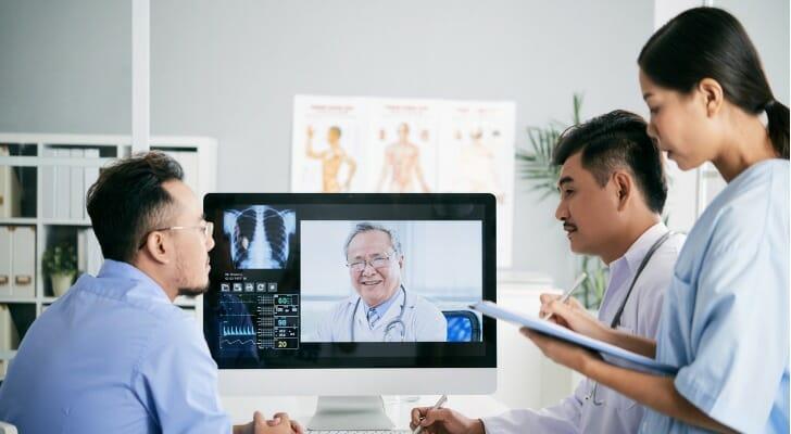 Physicians discuss a patient's diagnosis
