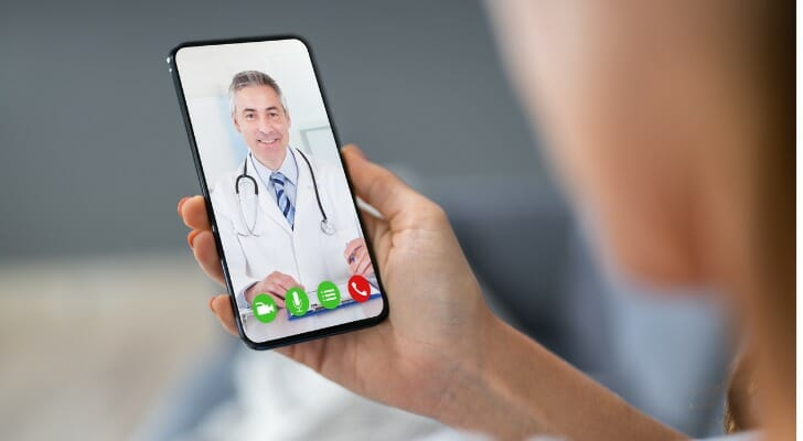 Physician video-chatting with a patient