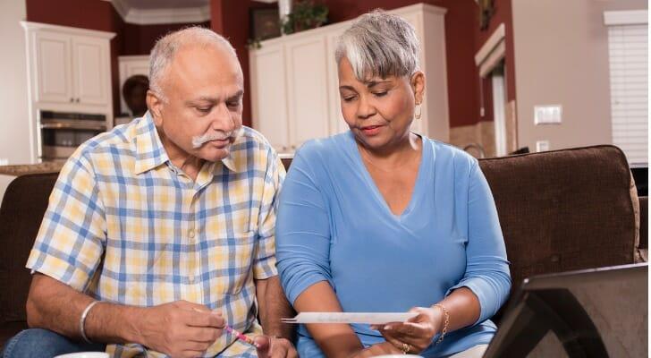 Senior couple preparing tax returns