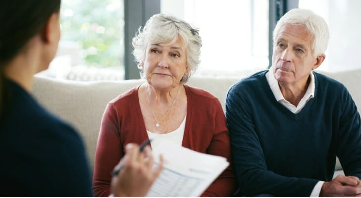 Senior couple discusses estate planning with a financial advisor