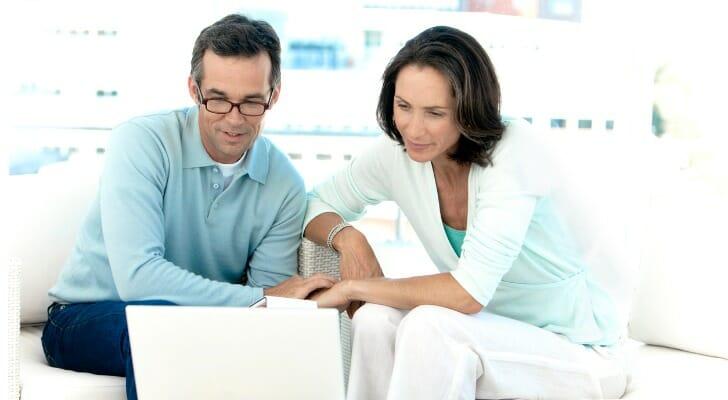 A couple prepares their taxes