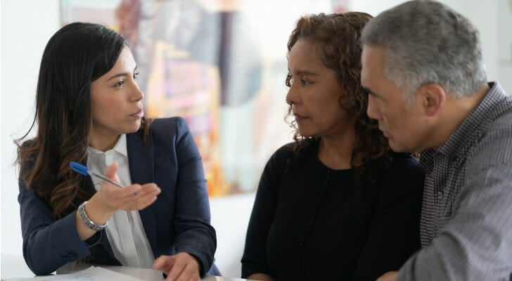 An attorney discusses a trust with her clients