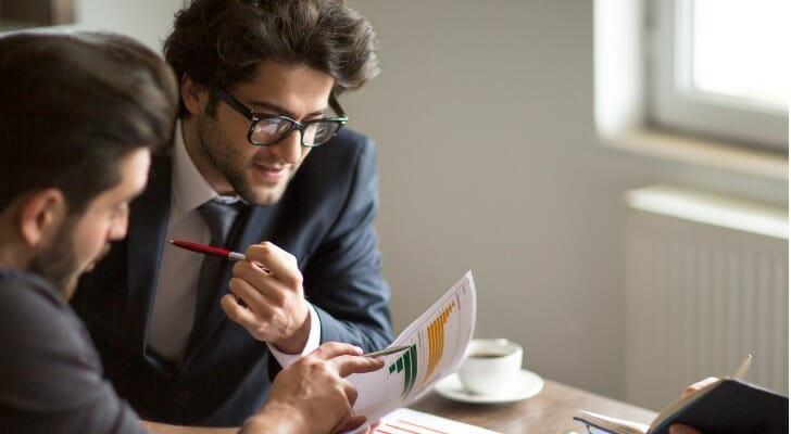 Business partners study a cash flow statement