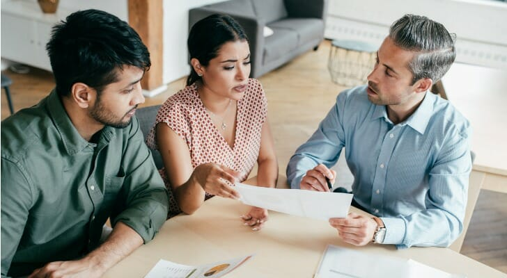 Couple discusses their tax returns with their accountant