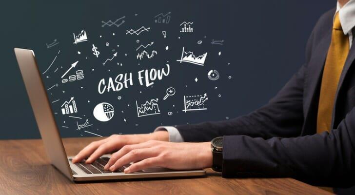 Businessman calculates operating cash flow