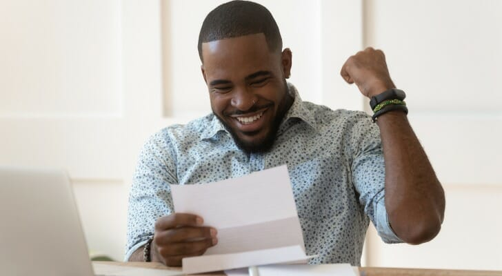 Taxpayer who is happy after finding lots of deductions, exemptions and credits
