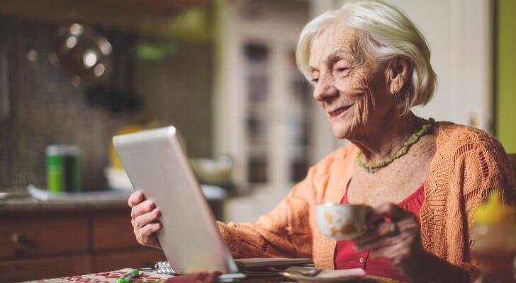 Senior woman checking her mobile budgeting app
