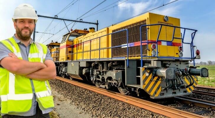 Railroad worker standing by railroad tracks