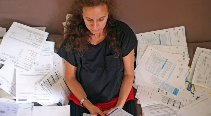 Woman surrounded by financial documents