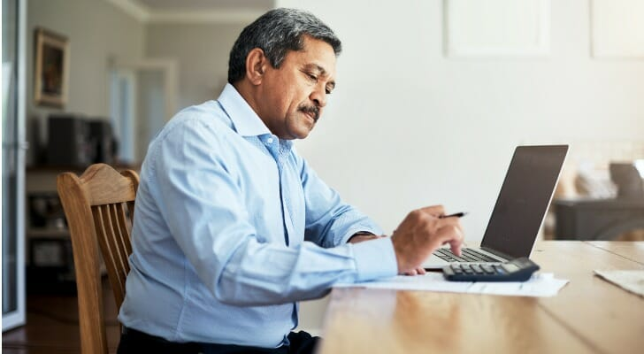 Man working on household finances