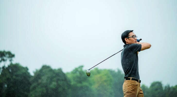 Asian man who just retired at 50, playing golf