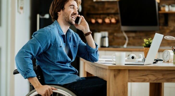 A wheelchair-bound man at work