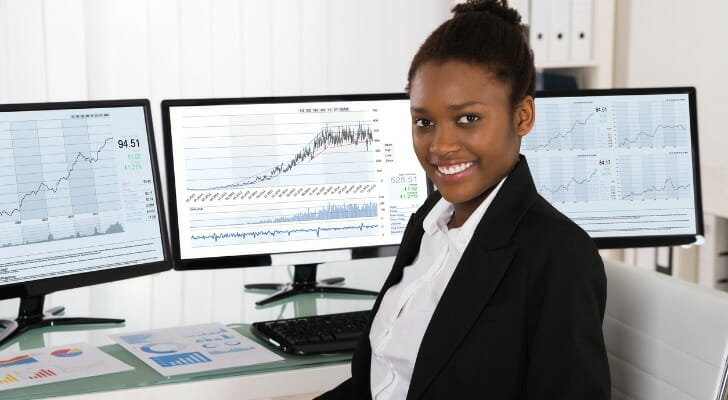Young African woman checking her investments
