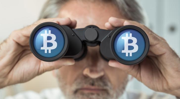 Man looking through binoculars and seeing the Bitcoin symbol